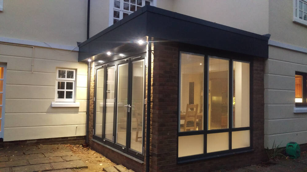 Classic, glass roofed conservatory transformed into a modern, contemporary glass room. Incorporating aluminium frames, full length bi-fold doors, Italian manufactured internal blinds, underfloor heating, aluminium powder-coated downpipes, finished off with state of the art LED downlights in Tonbridge Wells