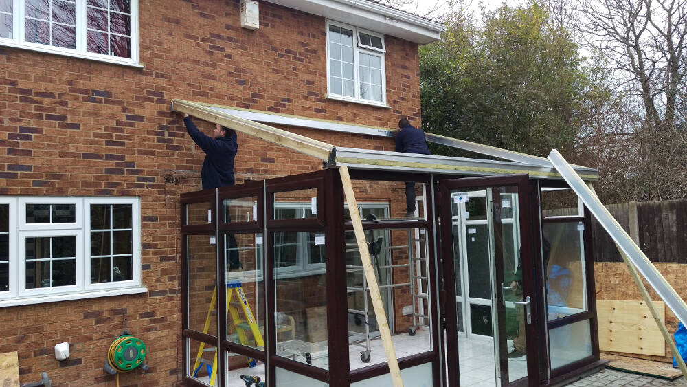 "A transformation from a classic ""lean-to"" conservatory with polycarbonate roof into a solid, composite tiled roof with Velux windows, internal bi-fold Oak doors, underfloor heating, roof insulation & LED downlights in Bromley"